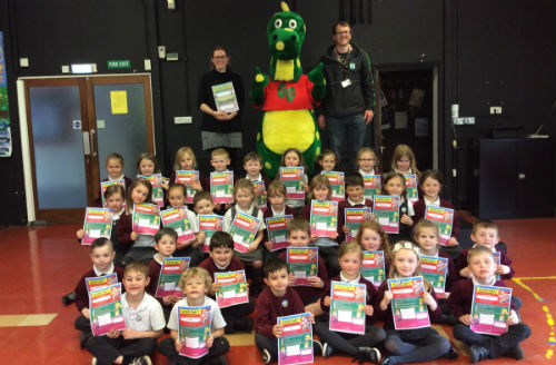 Pupils at Llangunnor School are presented with their Kerbrcaft certificates by Gary GoSafe and Carmarthenshire County Council's Kerbcraft staff and trainers.